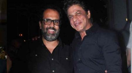 Shah Rukh Khan thinks it's not just director Aanand L Rai's 'dimples' which bring happiness on sets but somethingmore