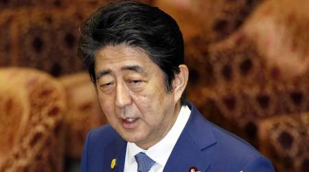Japan PM Shinzo Abe sends ritual offering to war dead shrine on World War 2 surrender anniversary