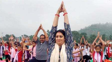 Yoga guru Ravi Shankar and minister Irani lead Yoga enthusiasts in Himachal