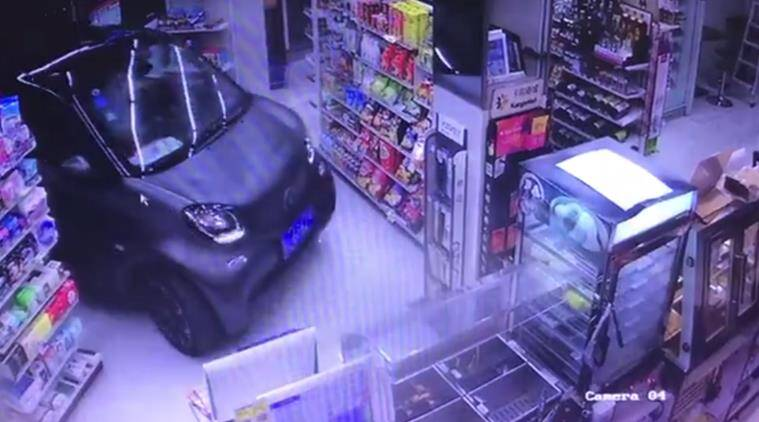 car, car into store, drive car store, car into convenience store, cctv camera car store, viral video, indian express, indian express news