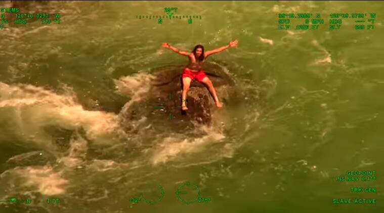 rescue videos, man rescued in a helicopter, swimmer saved in emerald pools, viral videos, indian express, indian express news