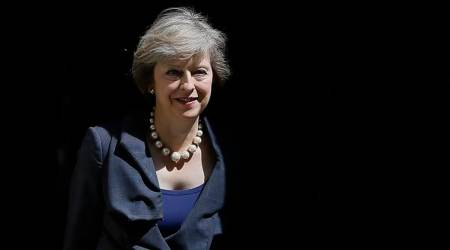 Show 'strength and unity', British PM Theresa May tells ministers