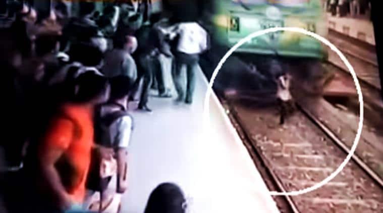 train, train accident, girl talks on phone train tracks, girl on phone train runs over her, train runs over girl, indian express, indian express news