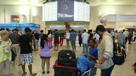 US govt settles first travel ban lawsuit withcampaigners