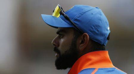 As a team we can put forward our views to the coach only if asked by BCCI, says Virat Kohli