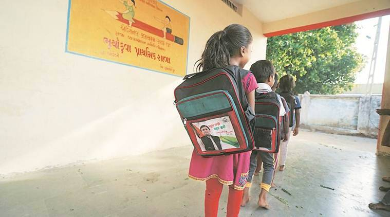 Chhota Udepur Enrollment Drive, School Bags Akhilesh photo, Akhilesh School Bags, Gujarat chool Bags Akhilesh photo, Education News, Indian Express, Indian Express News