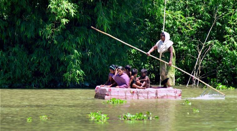 assam floods, northeast, brahmaputra river overflow, flood water receeding, indian express