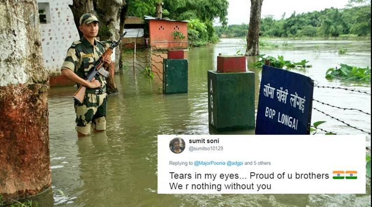 indian army, bsf, floods, army floods, jawan duty in flood, assam floods, jawan guarding in flood water, army viral photo, social media news, india news, indian express