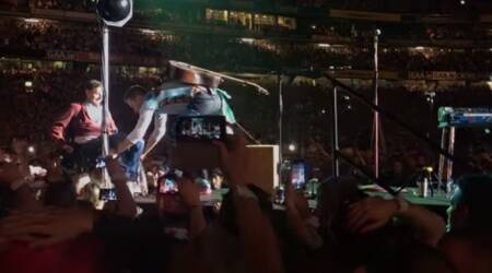 WATCH: Coldplay's Chris Martin invites crowd-surfing Irish fan in wheelchair on stage