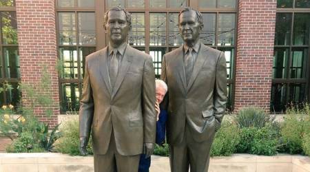 'Peek-a-Bill': Clinton literally hides between two Bushes and Tweeple can't stop poking fun at SeanSpicer