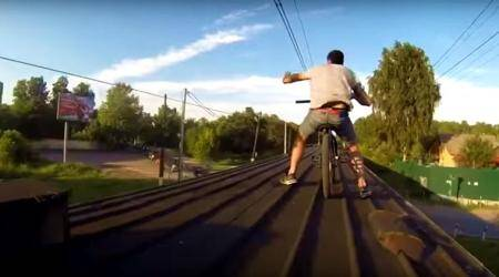 WATCH: Two cyclists hit off DAREDEVIL STUNT on a moving train (DO NOT TRY THIS!)