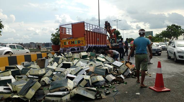 Image result for Truck carrying liquor topples at DND Flyway towards Noida, no casualties