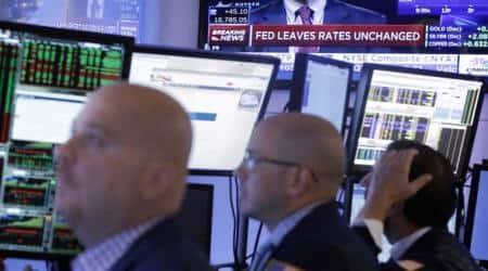 Asia stocks, dollar steady as investors await Fedclues
