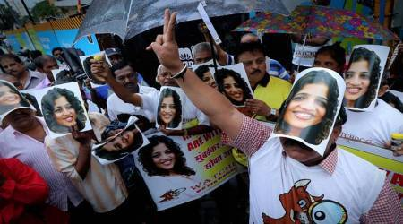 Supporters of RJ Malishka hold demonstration, wear 'Malishka masks' in Mumbai