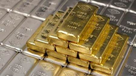 Gold futures fall by Rs 94 on weak global cues