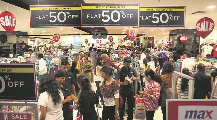 gst rollout, gst launch, sale, clothes sale, new tax rules, sale in delhi, levis, ucb, benetton, indian express