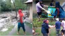 WATCH: Sikh men risk their lives to save items at a Mosque in Kashmir