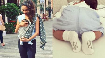 Lisa Haydon and son Zack are out for a walk and we can't stop gushing over the little munchkin. See photo