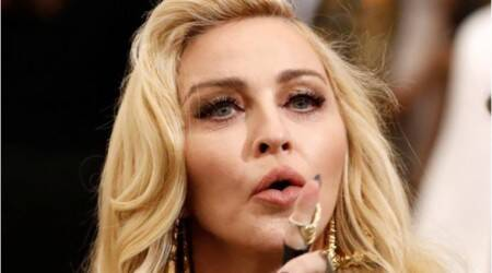 Madonna wins halt to auction of intimate items