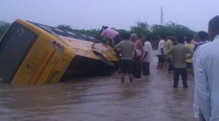 School bus gets trapped on flooded causeway in Gujarat's Morbi, 35 students escapeunhurt