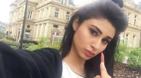 Mouni Roy slams those who doubted her success, joins the #LipstickRebellion movement. See photos