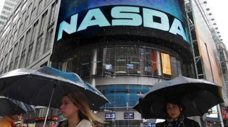 Nasdaq ends over 7,000 for 1st time, reflects growing US economy