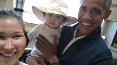 Alaska mom snaps cellphone pics of Barack Obama carrying her baby