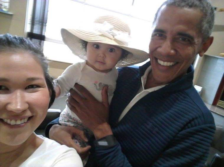 ... cellphone pics of Barack Obama carrying her baby | The Indian Express