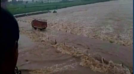 Flood triggered by heavy rains in Odisha's Kalahandi blocks NH-26