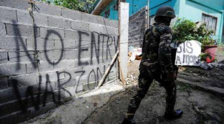 Filipino extremist blamed for bombings, killings surrenders