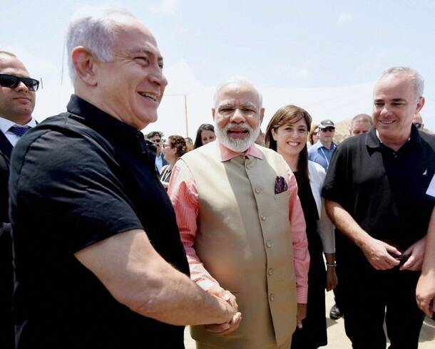 To the Gal-Mobile! Modi, Netanyahu drive water purification vehicle at Olga Beach