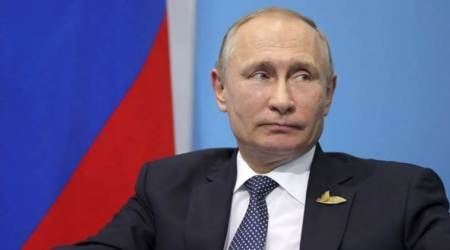 Vladimir Putin says 755 US diplomats must leave Russia