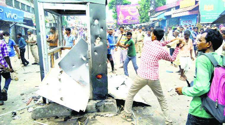 Raiganj violence, Raiganj adivasi rape, raiganj adivasi Attempted rape, raiganj North Dinajpur, Raigan shops torch, bengal news, indian express news