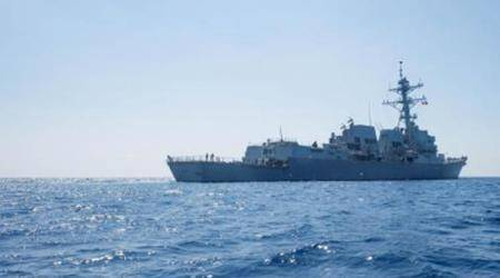 American navy ship sails close to South China Sea island occupied by Beijing: US official
