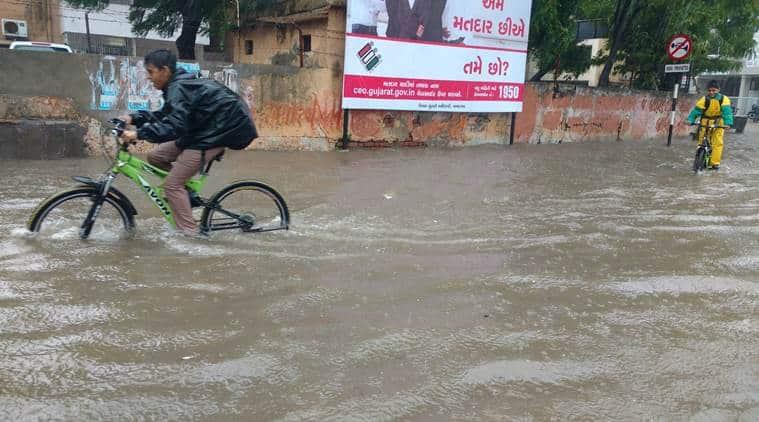 ahmedabad, ahmedabad flood, gujarat flood, gujarat flood relief, indian anavy relief, vijay rupani, gujarat waterlogging, indian express news, india news