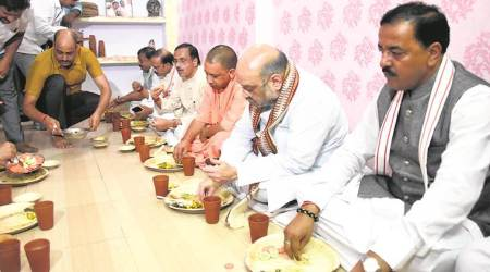 BJP chief Amit Shah, CM Yogi Adityanath dine at a Yadav home