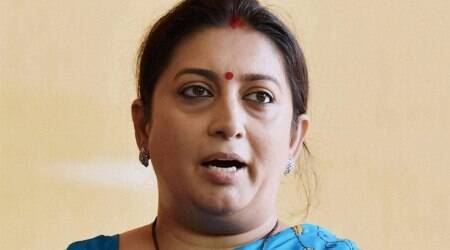 Adopt GST and become part of history: Smriti Irani to business community