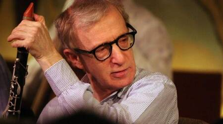 Oscar-winning director Woody Allen's concert disrupted by feminist activists