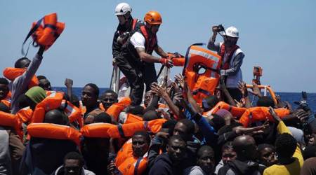 Armed group stopping migrant boats leavingLibya
