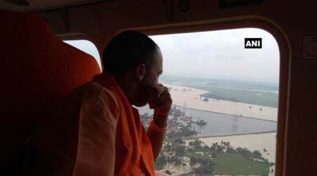 UP CM Adityanath undertakes aerial survey of Ballia and Azamgarh, distributes flood reliefmaterial