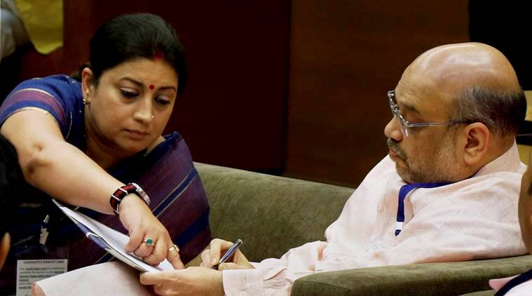 BJP president Amit Shah with Union Textile Minister Smriti Irani in the voting room at the Secretariat where voting for Rajya Sabha was held, in Gandhinagar on Tuesday, August 8. Image: PTI