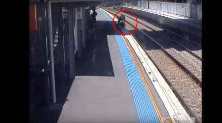VIDEO: Mom miraculously saves baby rolling towards railway tracks