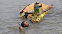 bihar floods, flood in bihar, kosi flood, bihar flood pics, bihar flood images, flood photos, bihar flood photo, darbhanga, gopalganj, kishanganj, madhepur, bihar flood death toll, flood bihar latest news, indian express