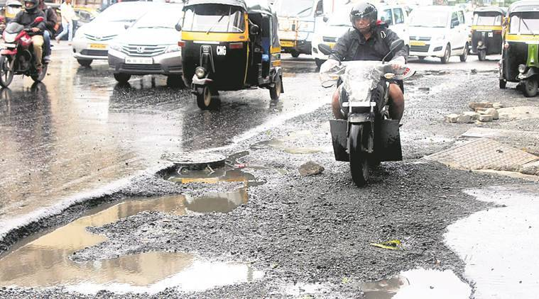 HC slams Mumbai civic body over potholed roads