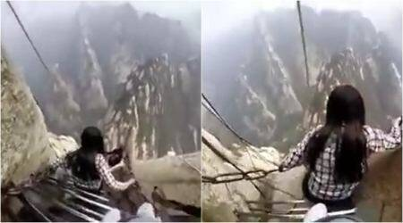 VIDEO: Are you brave enough to climb down these stairs along a cliff in China?