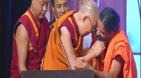 Watch video: Dalai Lama tugs Ramdev's beard at World Peace and Harmony Conclave