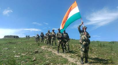 Keep the flag flying high: Indian Army soldiers patrol Line of Actual Control