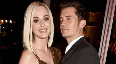 Singer Katy Perry and Hollywood star Orlando Bloom get cosy at an event. Are they back together?