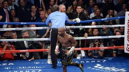 Floyd Mayweather beats Conor McGregor in TKO win; announcesretirement
