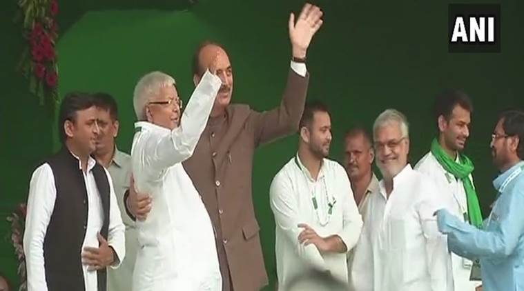 Congress leader Ghulam Nabi Azad joins Lalu, Akhilesh and other RJD members on the dais. (Photo: ANI)